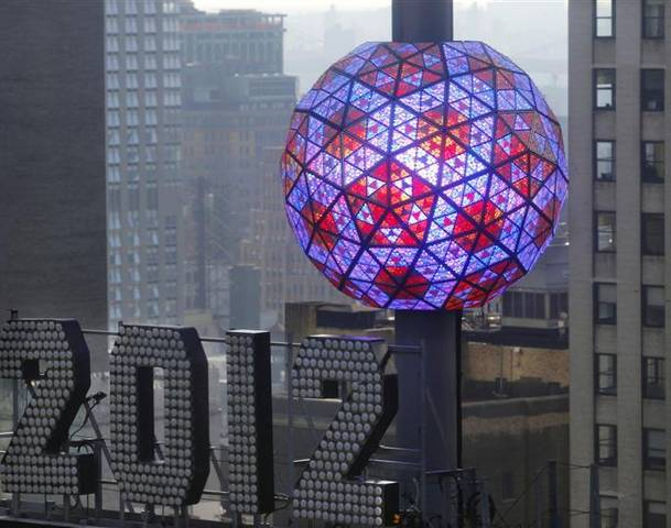 The New Year's Eve Ball, which measures 12 feet and weighs 11,875 pounds, and is adorned with 2,688 Waterford crystal triangles of various sizes is tested atop One Times Square in New York