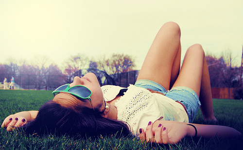 beautiful-girl-girl-laying-on-grass-glasses-grass-Favim.com-221827