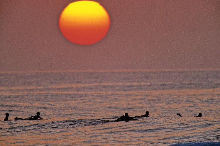 1119_1north_shore_surfers_paddle_sunset_by_jeff_diivne_